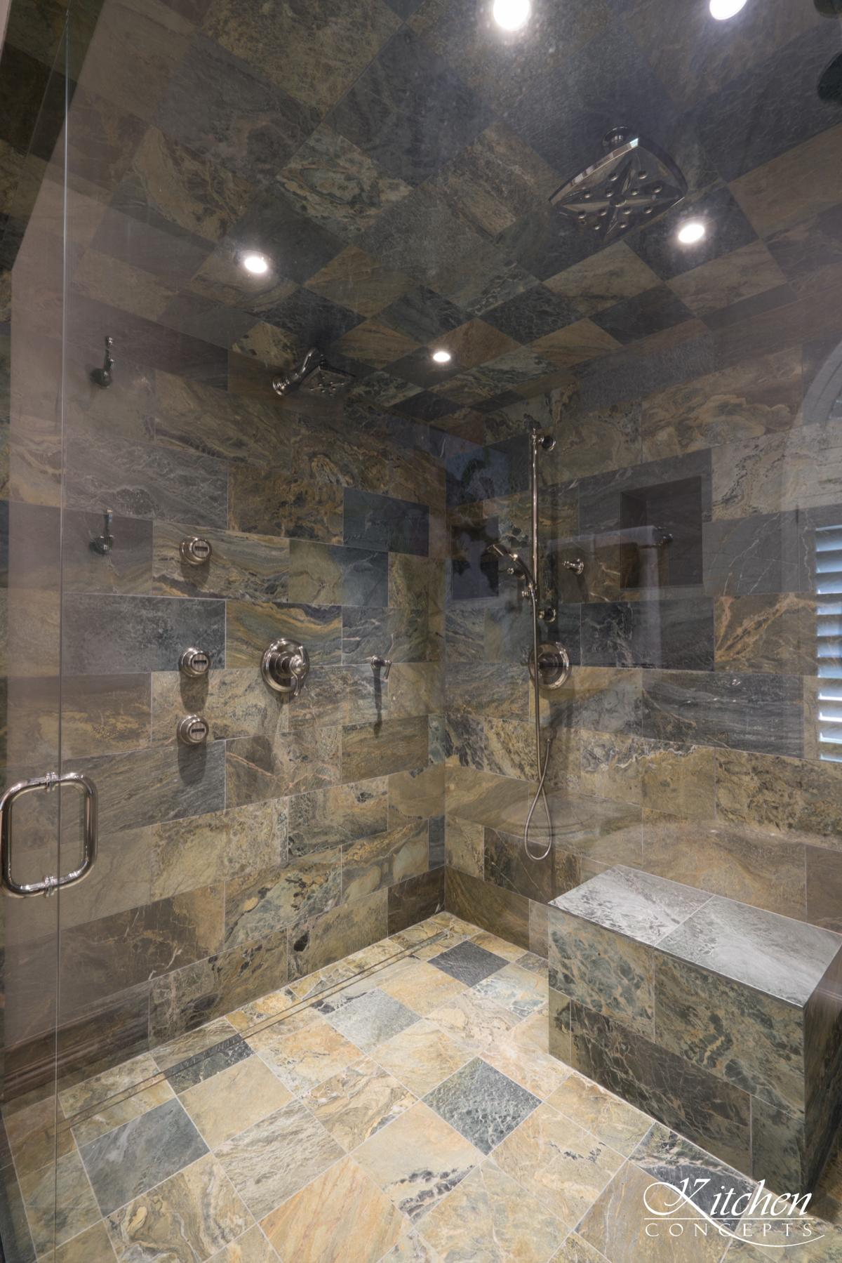 Large Bathroom Remodel With Classic Tub And Stone Tiled