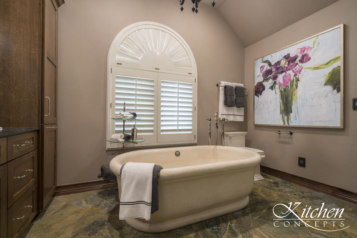 Large Bathroom Remodel with Classic Tub and Stone Tiled Walk In Shower