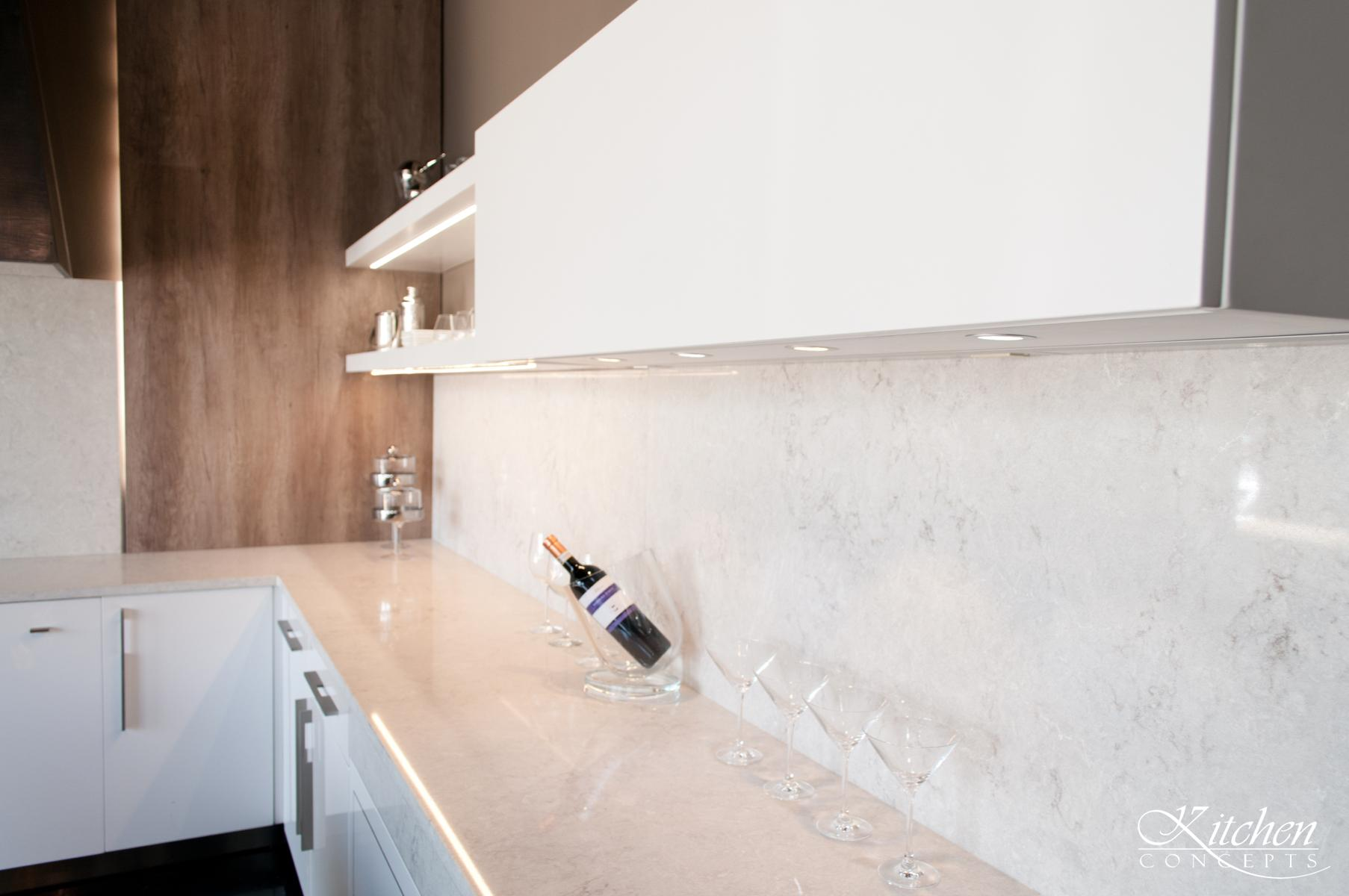 Minimal Nest Kitchen with White Counter and Cabinets - Kitchen Concepts